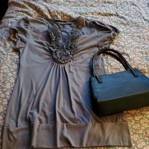 med sage short sleeve blouse and vintage purse
